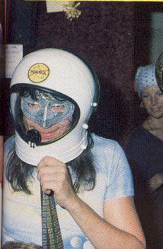 1977 - the band appear at a radio station sans make-up. Ace adorns a NASA helmet.