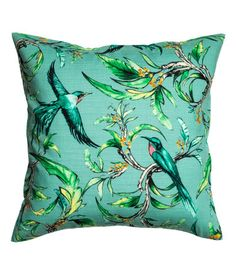 Turquoise/birds. Cushion cover in soft, woven cotton fabric with a pattern at front and solid color at back. Concealed zip.