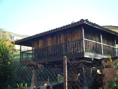 Horreo - traditional Asturian wood and stone granary.