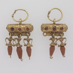 RISD Museum: Unknown artist, Roman. Pair of earrings of the Baretta type, 2nd century CE-3rd century CE. gold, coral, and garnet. 3.5 x 1.7 cm (1 3/8 x 11/16 inches). Gift of Mrs. Gustav Radeke 15.066