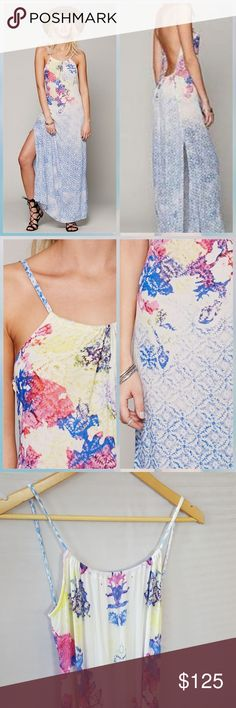 Free People Nomad Maxi Slip Blue Free People nomad maxi slip, blue, white, floral, pink, yellow.  Fabric is thin and a little sheer in the white parts, has a slit on each side, low scoop back, soft elastic gathering in back helps make it flowy, scoop neck is a bit adjustable with the gathering.  Perfe t for summer or lounging around the house anytime!  In excellent condition. Free People Dresses