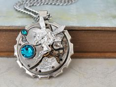ONCE UPON A TIME steampunk vintage  year 1907 waltham pocket watch movement necklace with winged fairy and Swarovski glass cab