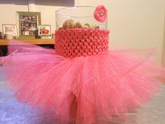 Make a tutu out of a crocheted headband and tulle !!!!  This is SO easy and adorable !!!