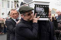 Martin Kemp (left) and Boy George carry the coffin of Visage star Steve Strange during his funeral at All Saints Church on March 12, 2015 in Porthcawl, Wales. Steve Strange was the lead singer of 1980s pop band Visage and died aged 55 following a heart attack on February 12.
