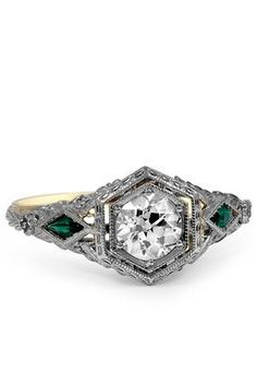 The Aurica Ring - almost perfect....just switch the diamonds and emeralds!