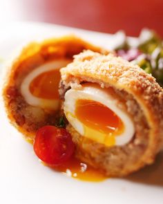 Japanese Bakudan Korokke (Croquette Bomb)  - wrap potato-meat mixture in video around a soft-boiled egg before breading and frying.