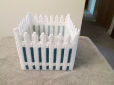 Planter Shaped as a Fence in plastic canvas by CraftsforSalebyJune on Etsy