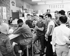 Activist Dion Diamond sitting on a counter stool during a civil rights sit-in, Arlington, 1960