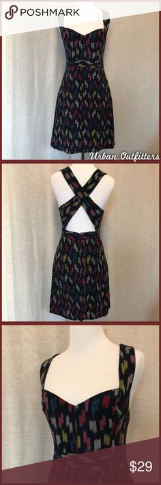 UO Criss Cross Back Dress Black criss cross back dress with colorful pattern in like new condition - brand is Staring at Stars, from Urban Outfitters. •I'm open to offers and negotiations on all items!• Urban Outfitters Dresses