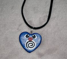 Polymer clay Pokemon Poliwag heart charm necklace by MyFantasyEverAfterUK on Etsy https://www.etsy.com/uk/listing/580917922/polymer-clay-pokemon-poliwag-heart-charm