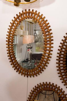 Oval Rattan Surround Mirror | From a unique collection of antique and modern wall mirrors at https://www.1stdibs.com/furniture/mirrors/wall-mirrors/