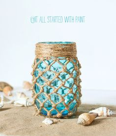 Macrame project to create a coastal look fishnet wrapped mason jar. Using jute rope and vintage-look blue mason jar. Includes step-by-step diy instructions.