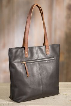 Premium Argentine cowhide leather with contrast leather handles give this tote its fashion appeal.