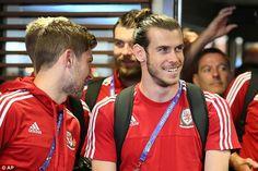 Real Madrid forward Bale grins alongside Tottenham defender Ben Davies (left) at the team hotel