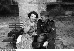 A German soldier drinks with his collaborationist girlfriend in newly-occupied France (August-September 1940). Bundesarchiv Bild 101I-058-1760-26A