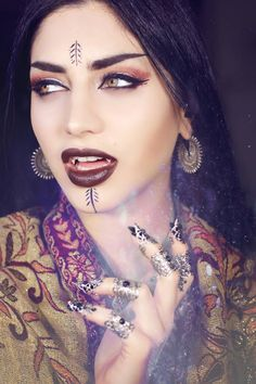 Model/PhotoMakeup/Styling/Editor: Mahafsoun Fangs: Father Sebastiaan Claws: Freckles Fairy Chest Earrings: Maya Jewelry Lipstick: Necromancy Cosmetica Welcome to Gothic and Amazing...