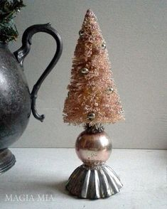 Whataya do with one little lonely pink mercury ball, an old tart tin, and a bleached bottle brush tree? You make this sweet little… Vintage Christmas Crafts, Pink Christmas, Rustic Christmas, Christmas Projects, Handmade Christmas, Holiday Crafts, Christmas Holidays, Xmas Tree, Christmas Tree Decorations