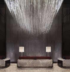 Four Seasons Hotel in Pudong // MGV - The lighting fixture is simply incredible...If I only had high ceilings at home I could see this handing in my living room.
