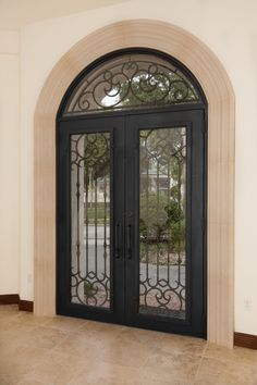 Wrought-iron double entry door, designed by owner and made in Mexico for Orlando Custom Builder Jorge Ulibarri, www.imyourbuilder.com and for more design ideas check out the series Trade Secrets at www.youtube.com/tradesecretsbyjorge Entrance Ideas, Grand Entrance, Door Ideas, Mediterranean Homes Exterior, Mediterranean Decor, Iron Front Door, Front Doors, Mexico House, Double Entry Doors