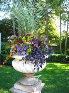 Gorgeous fall planter with lovely colors of fall~ Ornamental cabbage and grasses among others...