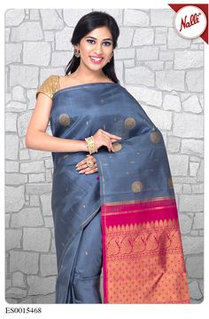Elegant Grey Kanchipuram Silk Saree, with a fine line of zari border and subtle golden embellishments on the body. The royal pink pallu with zari work simply brings out the delightful appearance.