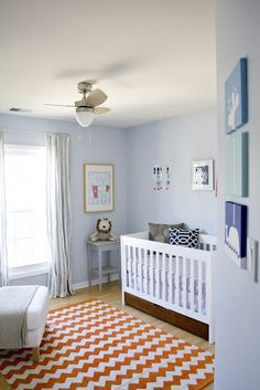 Blue walls for boy. LOVE the bright chevron rug in the nursery!