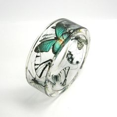 OMG. This is beautiful! -- Emerald and black Butterflies Resin Bracelet, Resin Bangle. $50.00, via Etsy.