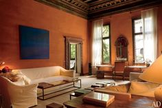 Inspiring Living Rooms of Architects and Designers. Axel Vervoordt's 15th Century Palazzo.  Complementary colors - blue and orange.