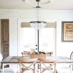 How glorious does our Mia Chandelier look in the dining room of @katienisbett?  The fixture is a wonderful addition to Katie's French country inspired space. #frenchcountry #diningroom #mypotterybarn