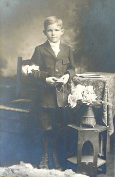 boy holding rosary an old studio photo, most likely a first Communion photo