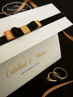 Pocket wedding invitations with layered ribbon loops. www.weddingart.co.nz
