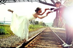 Beautiful Wedding Couple holding hands and posing on the train tracks in the Sunlight | New York, NY Wedding Photography by Anna Rozenblat | Available anywhere on the NY tristate area & Boston, MA | www.AnnasWeddings.com