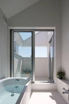 等々力の家: アトリエ スピノザが手掛けたtranslation missing: jp.style.洗面所-お風呂-トイレ.minimalist洗面所/お風呂/トイレです。