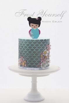 Kokeshi doll cake with rice paper flowers and Japanese fish scale stencil by Frost Yourself, via Flickr