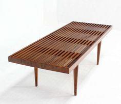 Danish Mid Century Modern Slat Wood Walnut Bench | From a unique collection of antique and modern benches at http://www.1stdibs.com/furniture/seating/benches/
