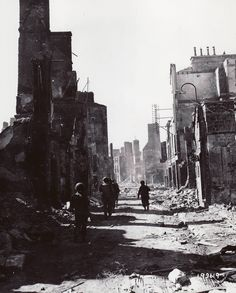 30th Infantry Division troops in Mortain on Aug. 13, 1944, after repulse of German counterattack.