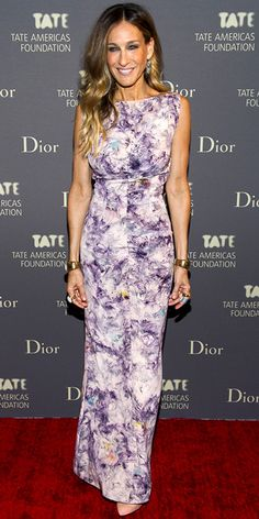 Sarah Jessica Parker wearing a printed column with tasseled earrings, gold cuffs and pastel Roger Vivier heels.
