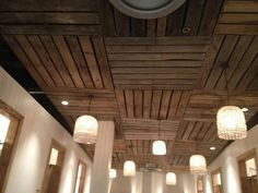 Or maybe faux-wood paneling or wallpaper (fabric basement ceiling wooden ideas with down light)