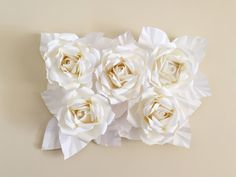 PaperPosh Events bundle of 5 handmade Paper Flowers are perfect for any event or home!  From Weddings to Baby Showers, Birthday Parties, Bridal Showers, Holidays and Home decor, they are sure to WOW everyone who sees!  We custom make each order to fit your specifications! So feel free to message us with your ideas and we will help you make when come to life!  This display is for 5 white (or any color card stock) roses, but feel free to message us if you would like to custom pick your colors…