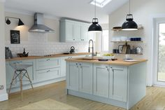 Beautiful kitchen from WREN, in Ermine Pale sky. DOOR STYLE: Shaker, DOOR COLOUR: Ermine Pale Sky, WORKTOPS: Aragon Oak Matt, HANDLES: Doris, WALL TILES: White Metro, FLOORING: Solid Oak, WALLS: Old English White http://www.wrenkitchens.com/online-planner/complete/designer-range