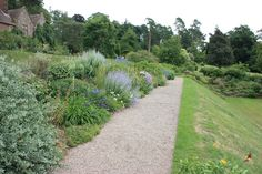 To create a decent depth of border at Knightshayes, Devon, the path has been moved to one side of the terrace. If the path was central to the terrace it would create two very narrow borders with limited potential for planting.