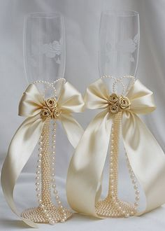.Ribbon decorated wedding champagne glasses.