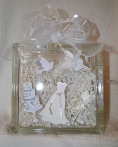 This is a beautiful Glass Block 8x8x3 featuring WEDDING in 3D stickers with…