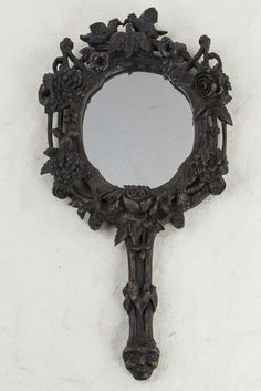 """Hand carved Black Forest hand mirror with lovebirds, c. 1900. May also be hung on the wall. 15"""" L X 8"""" W"""