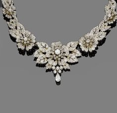 Diamond Necklace - c. 1890 - 5.6 cttw old brilliant, single and rose-cut diamonds, with a pear-shaped diamond drop - mounted in silver and gold.