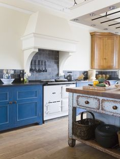 Country Kitchen With Blue Cabinets And White Range   Lonny