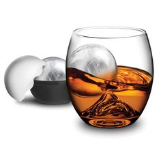 """A gift for dad on Father's day that will give him better flavor, better aromas, and a better way to drink his favorite beverages 'on the rocks.' Glass tumbler has a special rock shape on the bottom of the glass.  Swirling the ice ball around releases aromas and flavors in your scotch, whiskey, bourbon or other liquors."""