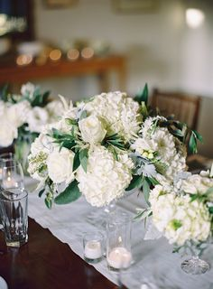 fluffy hydrangea centerpieces Photography: The Great Romance Photo - thegreatromancephoto.com #SMP Read More: http://www.stylemepretty.com/2014/04/04/elegant-san-ysidro-ranch-affair/