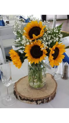 Birch Tree slices I cut for a bride to use as centerpieces at her wedding.  She used Mason jars as a base for the lovely happy Sunflowers!
