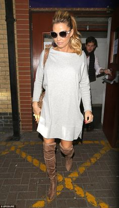 There's no rest for the wicked: Katie Price slipped into a pair of brown suede thigh-high ...